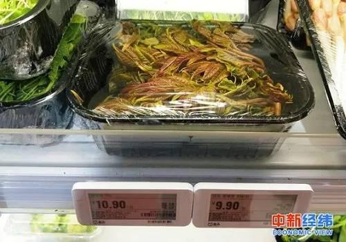 货架上的香椿芽,标价为9.9元/100g 中新经纬 赵佳然摄
